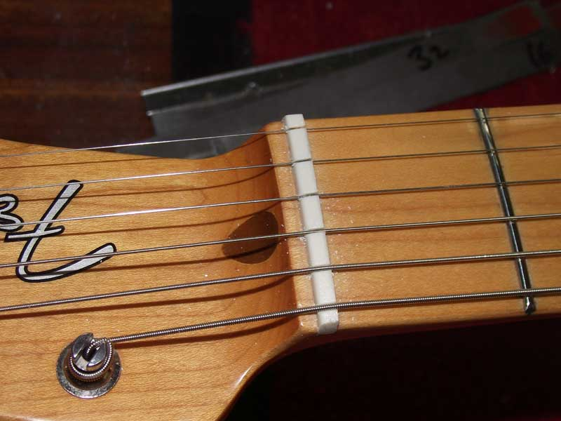 Bass guitar nut slots