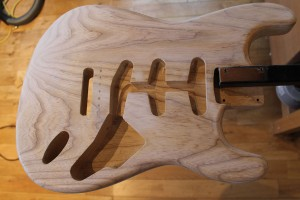 Sealer coat on Stratocaster body sanded and ready for colour
