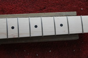 The fret ends have been clipped short using pincers