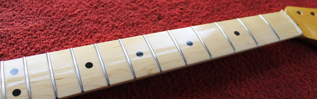 Completed neck showing polished frets