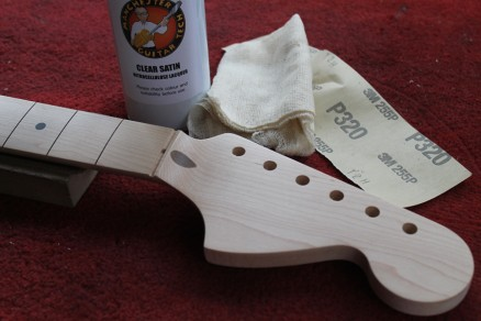 Preparing the neck by sanding and sealing with clear lacquer