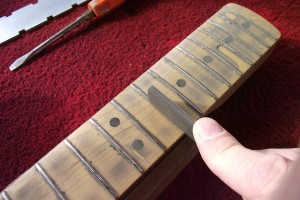 Re-crowning the frets using a crowning file